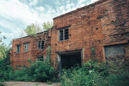 Abandoned Industrial Buildings from red bricks. Ruined car workshop Stock Photo