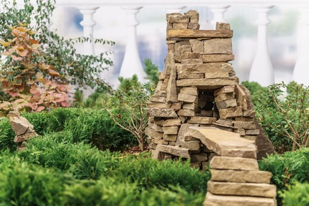 cave house: Decorative small house for garden in the form of a stone cave with a ladder