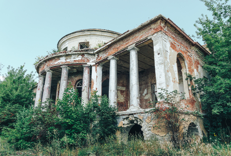 Abandoned ruins of mansion, facade with columns. Penza Region, Russia Stock Photo