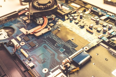 information science: Disassembled laptop. Technology and hardware electronic concept. Motherboard digital chip. Tech science background. Integrated communication processor. Information engineering component Stock Photo