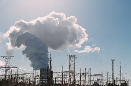 npp: Clouds of thick smoke NPP Nuclear Power Plant in rays of bright sunlight