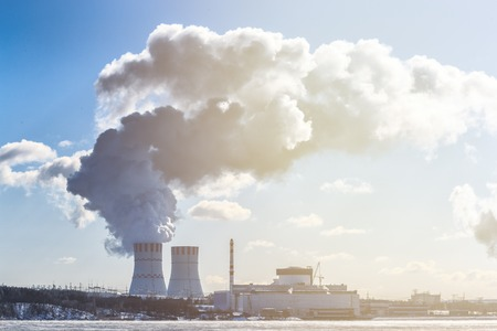 npp: Landscape with view of Nuclear power Plant from cooling pond. Clouds of thick smoke on blue sky background at Sunny day. Copy space