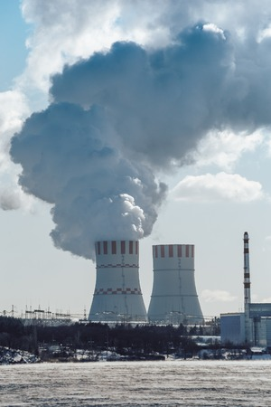 npp: Cooling towers of NPP or Nuclear Power Plant with thick smoke. Vertical image Stock Photo