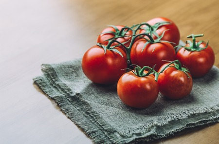 Fresh grape tomatoes with spices for use as cooking ingredients. Healthy eating.  copy space