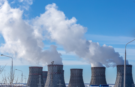 npp: Cooling towers of Nuclear power plant or NPP in Novovoronezh on background of blue sky Stock Photo