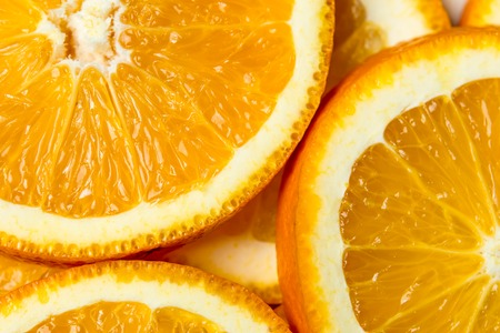 Fresh cut orange fruit background, many pieces of oranges, macro close up photo of healthy food, top view 版權商用圖片
