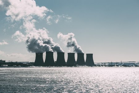 npp: Cooling towers of NPP or Nuclear Power Plant with thick smoke. Dark toned image. Ecological disaster concept