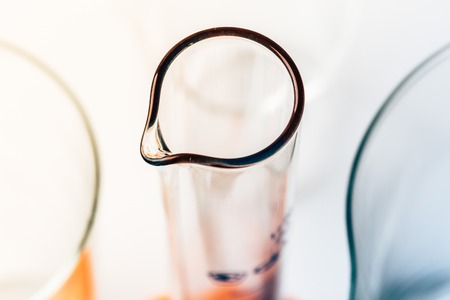 Laboratory background, top view of test tube or flasks, or beakers, selective focus, warm and cold tones, copy space