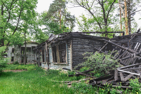 Ruined abandoned burnt-out wooden house Stock Photo