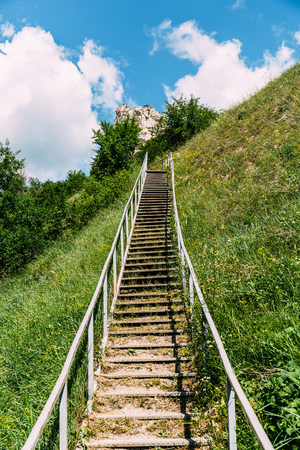 walking paths: Man-made staircase upstairs to the hill with green grass, travel and tourism concept, Divnogorie, Voronezh region vertical image Stock Photo