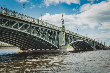 Saint Petersburg bridge, Trinity Bridge or Troitsky bridge over the Neva river, view from water Stock Photo