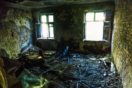 demolished house: Interior of the burned by fire house, burned furniture