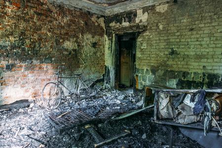 demolished house: Burned apartment, furniture, remnants of the interior