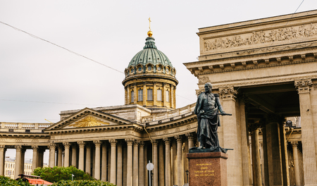Colonnade, monument to Field Marshal Barclay De Tolly and dome with golden cross on Kazansky cathedral or Kazan Cathedral in Saint Petersburg, Russia