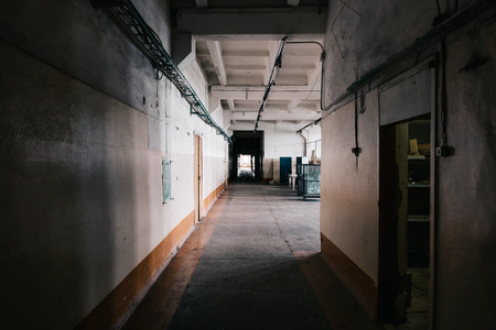 empty warehouse: Inside dark Industrial factory building, tunnel vision, perspective