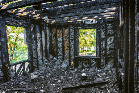 sunburnt: Interior of a burnt by fire apartment building. Burned wooden beams in burned house