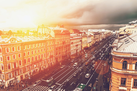 Saint Petersburg, view to Nevsky prospect from roof top. Big city urban downtown concept. Toned with sunlight effect Stock Photo