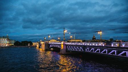 The Palace Bridge - drawbridge across the Neva River in St. Petersburg in evening with illumination Stock Photo
