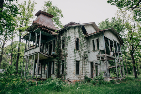 Two-story abandoned wooden antique vintage mansion
