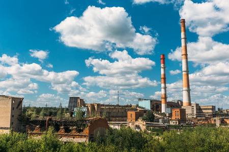 Industrial landscape. Metallurgical plant or factory. Pipes, factory buildings, steelworks, iron works. Heavy industry, bright blue sky for copy space