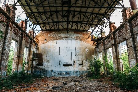 empty warehouse: Large abandoned warehouse in Efremov factory, broken brick walls, rusty interior Stock Photo