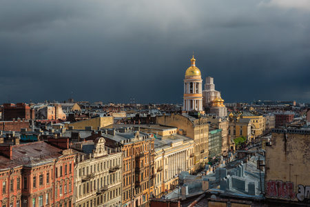 Panorama of St. Petersburg roofs, church or temple with golden dome, aerial view