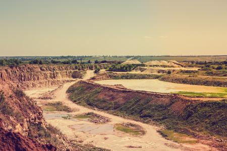 dredging: Quarry landscape, opencast mining of copper, silver, gold, minerals. Toned image
