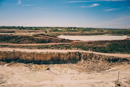 sand quarry: Open cast limestone yellow mining quarry landscape, toned Stock Photo
