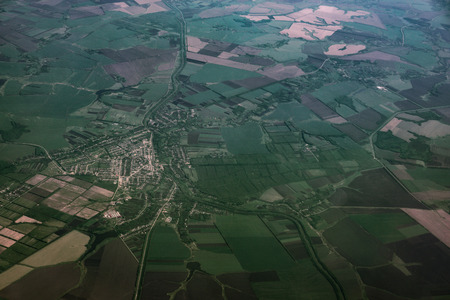 blue green background: Top view of land, green fields with roads, aerial view from airplane window, toned Stock Photo