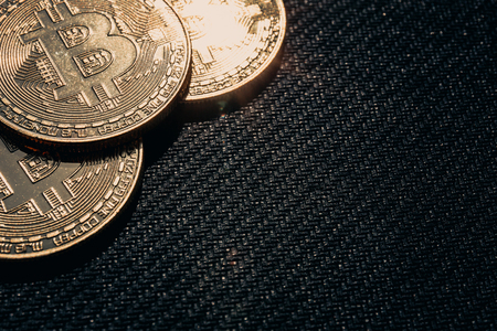 Coins of Bitcoin on black, toned, copy space Stock Photo