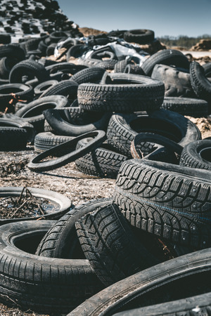 auto repair: Pile of old rotten rubber tires background, vertical image