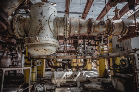 Metal Fuel and Power Generation Rusty Equipment in Abandoned Factory Interior, toned