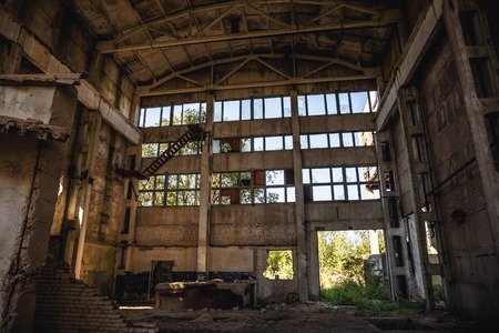 empty warehouse: Large abandoned factory building or warehouse, ruined Soviet factory