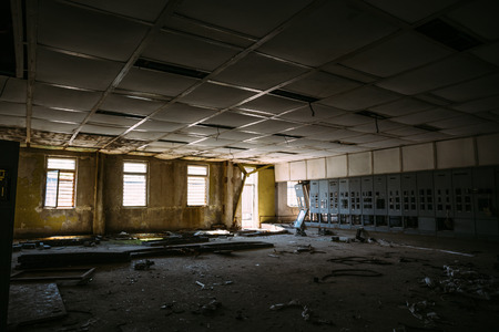 empty warehouse: Abandoned building inside interior, large dark room with windows and light from it Stock Photo
