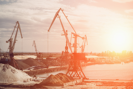 Gantry cranes, industrial landscape at sunset, toned Zdjęcie Seryjne