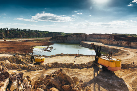 heavy industry: Quarry landscape and equipment with heavy duty machinery, excavators and loaders. Construction industry concept