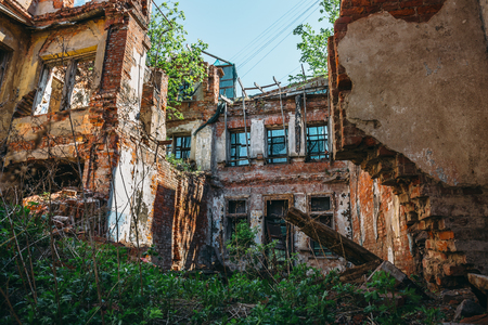 Inside ruined abandoned house building after disaster, war, earthquake, Hurricane or other natural cataclysm Stock Photo