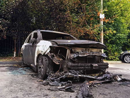 burned out: Burned car, burned-out car body Stock Photo