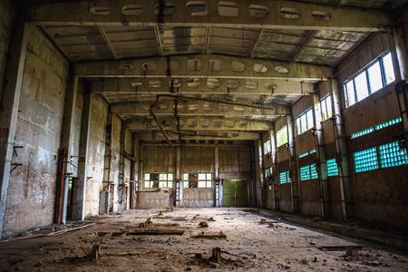 Abandoned warehouse building or factory workshop, dark retro toned