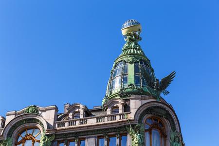 Bronze dome of Singer House on Nevsky Prospekt in Saint Petersburg, Russia