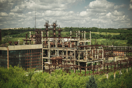 Aerial view of abandoned industrial landscape from above, concrete buildings, industry and agricultural district, toned