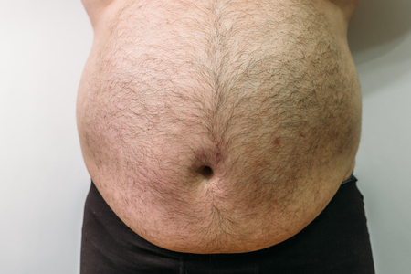 Fat man with big belly, overweight person, close up