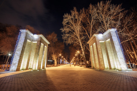 Entrance to Dynamo Park in Voronezh city, Russia in winter time, public place for rest and walking in modern city