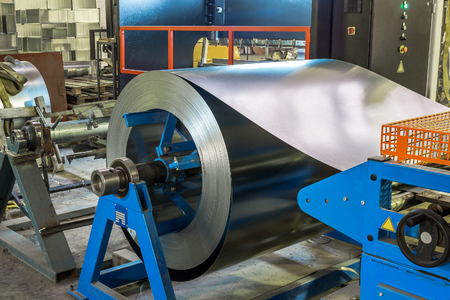 Metal round roll of galvanized stainless steel sheet, industrial metalwork machinery manufacturing concept