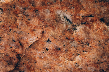 Wild orange marble stone surface texture, as abstract geologic background