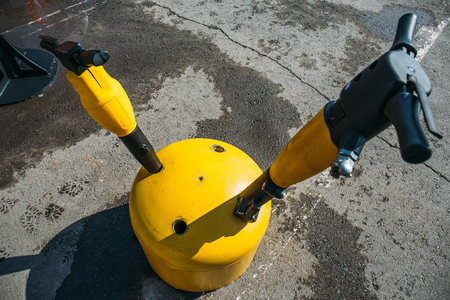 Modern jackhammers in holder for construction, top view 写真素材