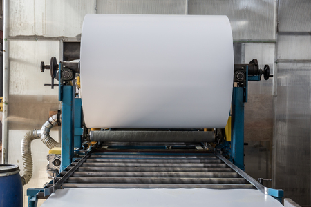 Roll of galvanized steel or metal on machine in industrial workshop on rolling mill, manufacturing metalwork factory for production sandwich panels, toned