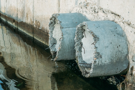 Concrete drainage or sewerage pipes, dirty water and environment pollution concept Stock Photo