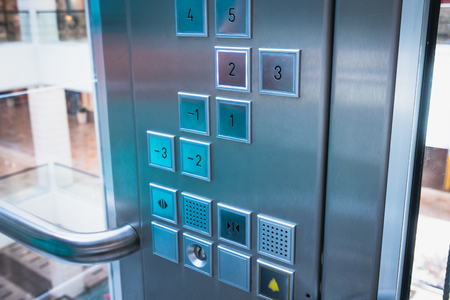Elevator buttons control panel in modern business building or Mall or shopping center, close up, toned