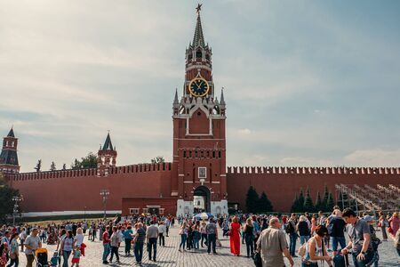 Moscow, Russia - September 2018 : Tourists behind The Spasskaya Tower is the main thoroughfare tower of the Moscow Kremlin located on Red Square, was built in 1491 Editorial